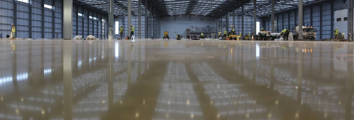 Laying screed in Leicester walkers factory